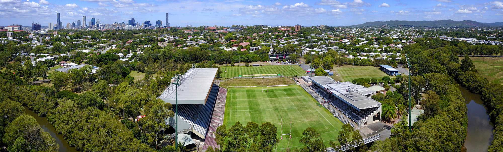 Aerial Drone Photography of Ballymore Park with Brisbane in the background during the midday