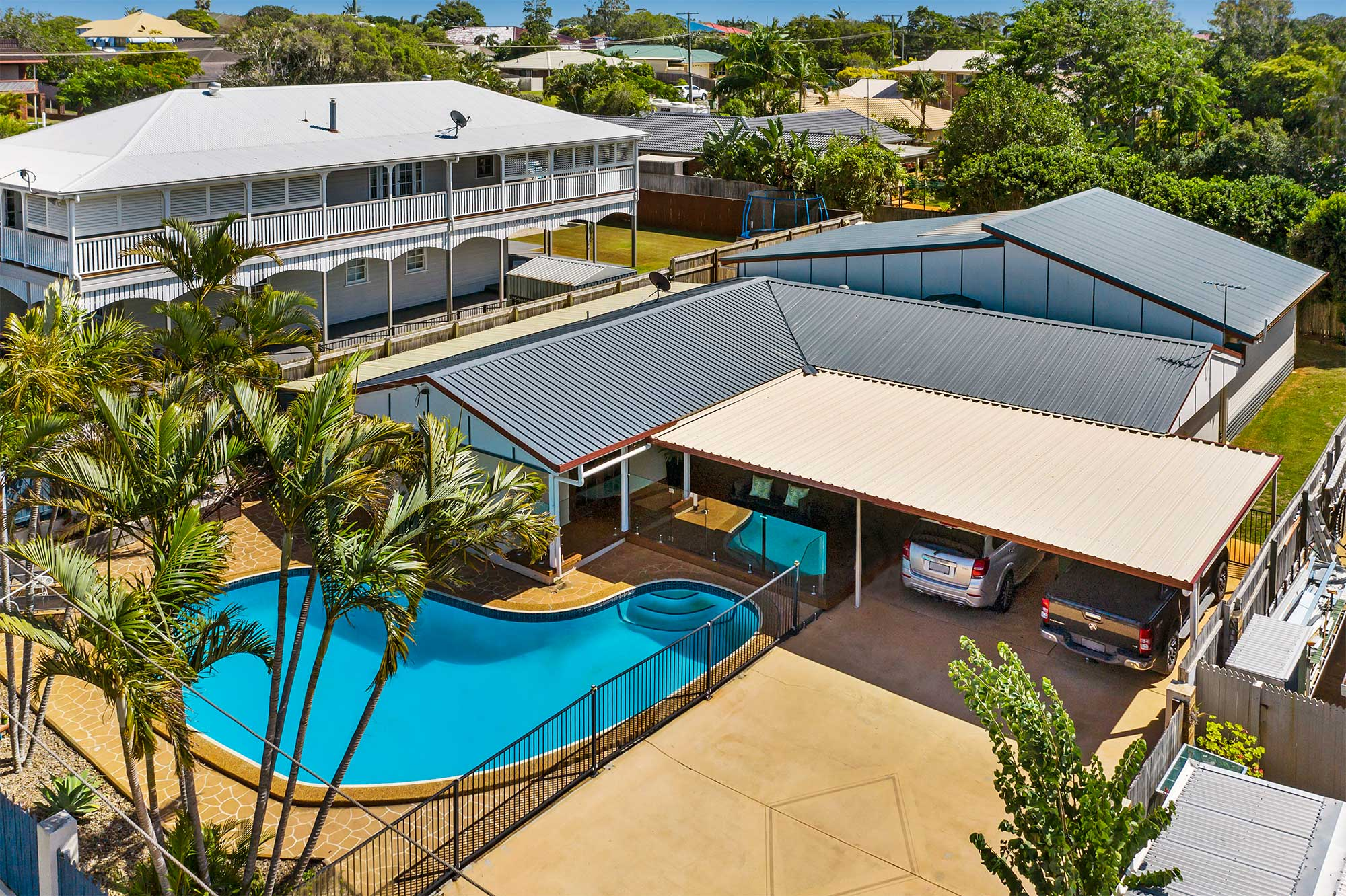 Drone photography of home for sale at Victoria Point highlighting the swimming pool area