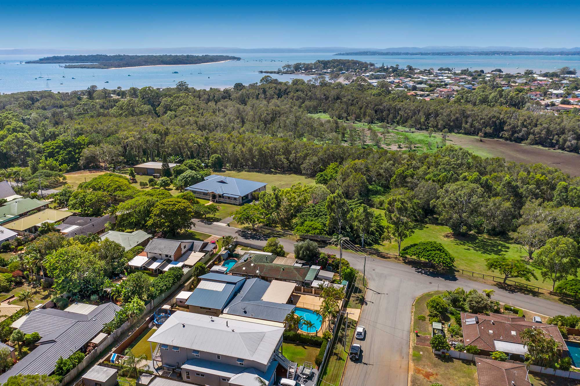 Drone photography of home for sale at Victoria Point highlighting proximity to Morton Bay