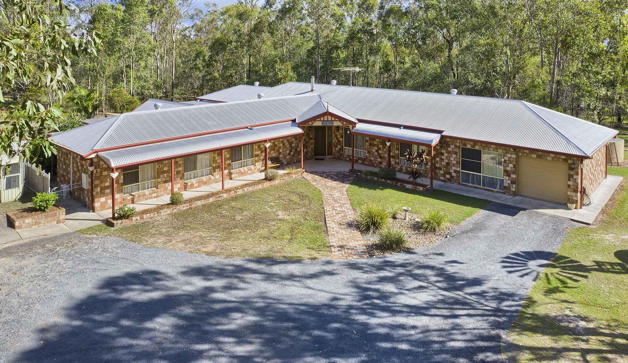 The main residence  - Drone photography acreage property for sale at 56 Sandpiper Drive, Jimboomba