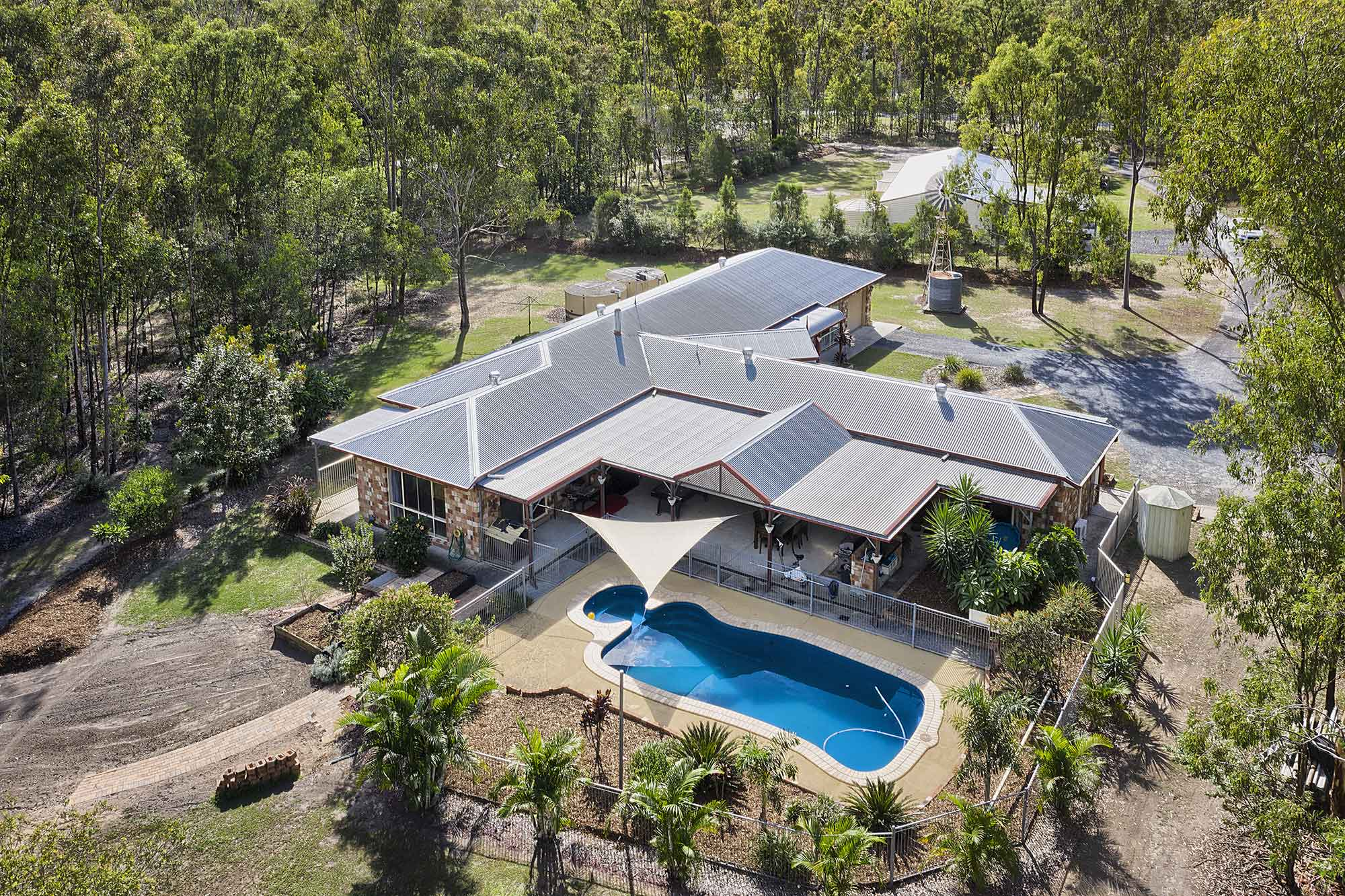 Drone photography of the pool - acreage property for sale at 56 Sandpiper St Jimboomba