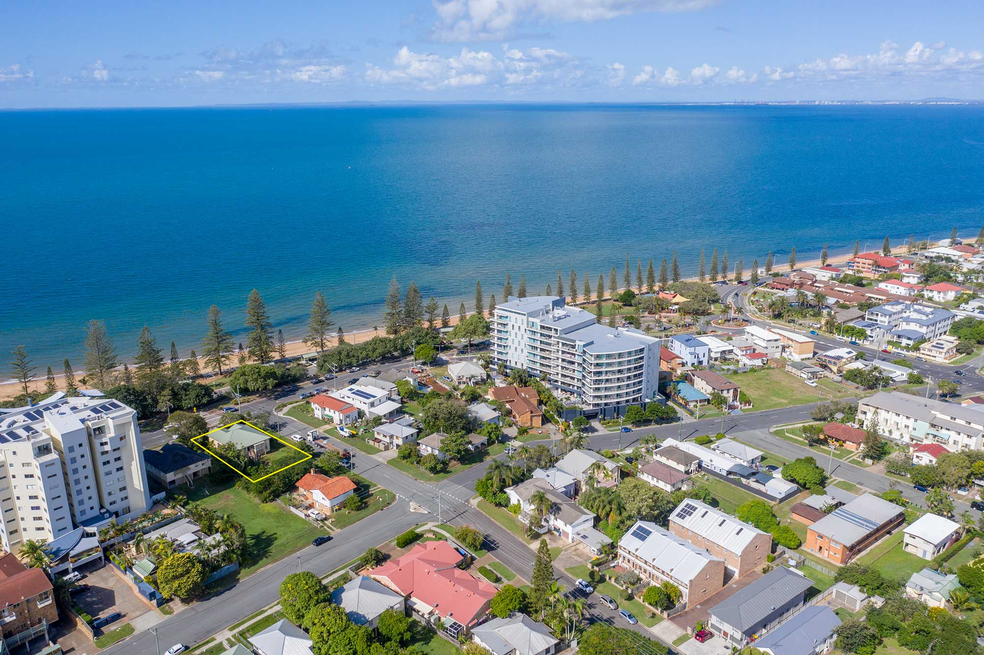 Looking south down the beach at 37 Marine Parade, Redcliffe