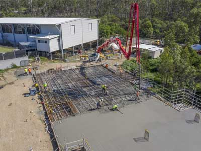 Drones in construction - photography for INTREC Management concrete slab pour at Augusta State School