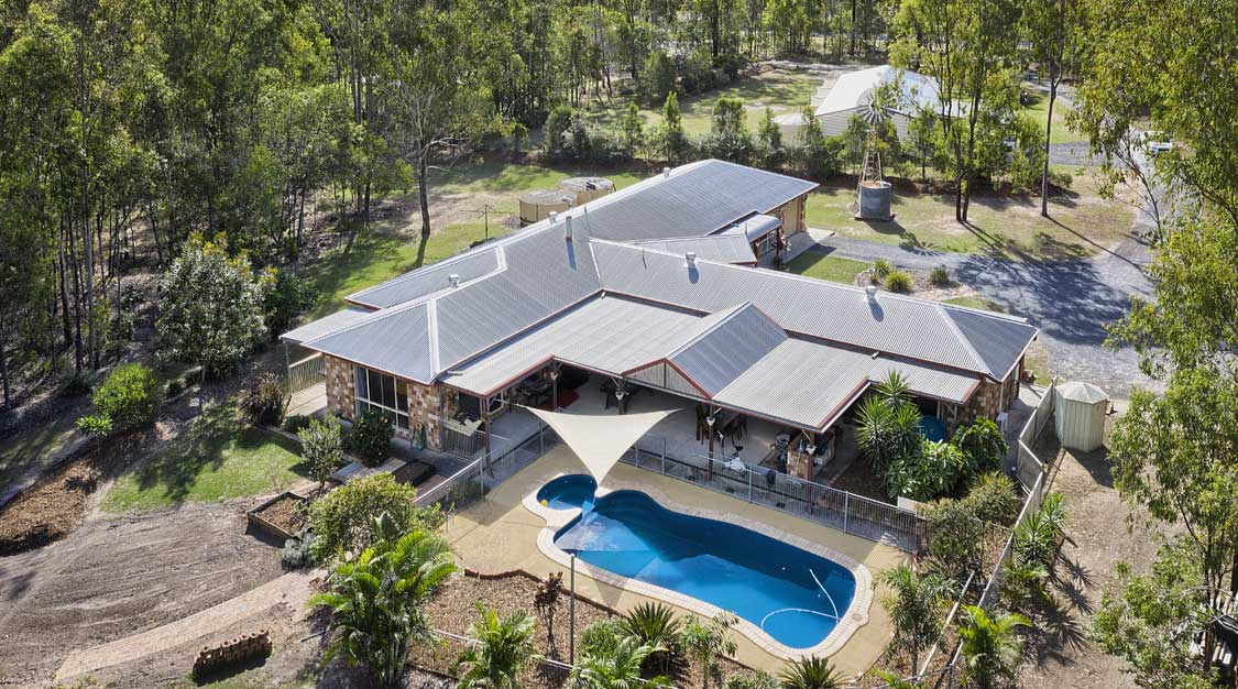 Drone photography for acreage real estate listing at Sandpiper Drive Jimboomba