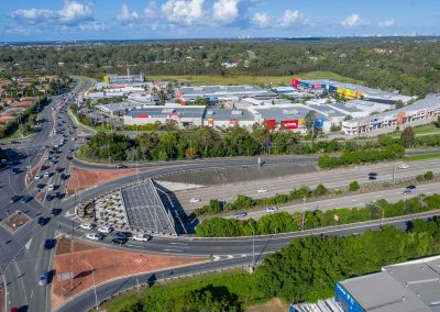 Drone video of the Homeworld Helensvale shopping centre flying along side the M1 motorway