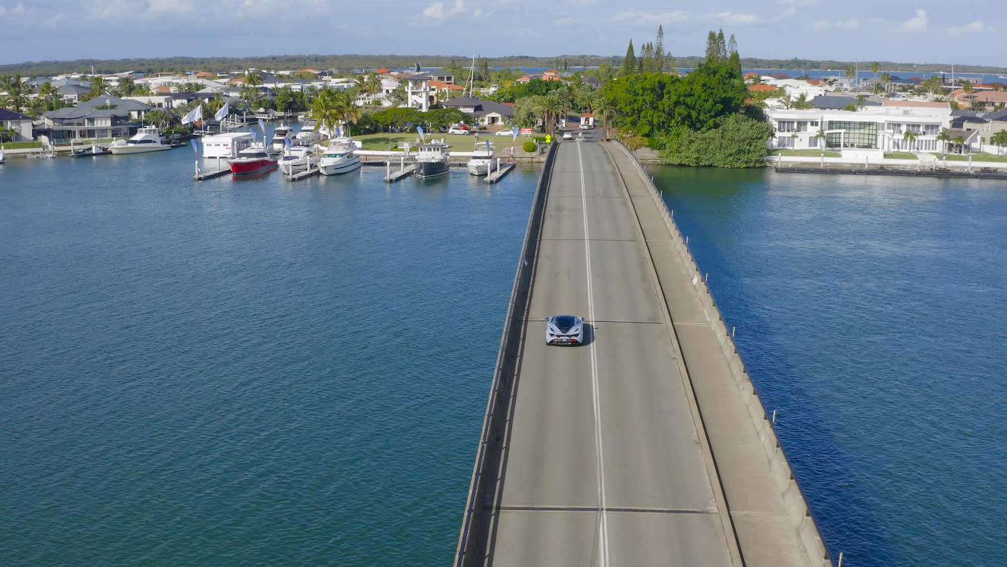Drone video of a McLaren sports car at Soverign islands captured for a promotional video