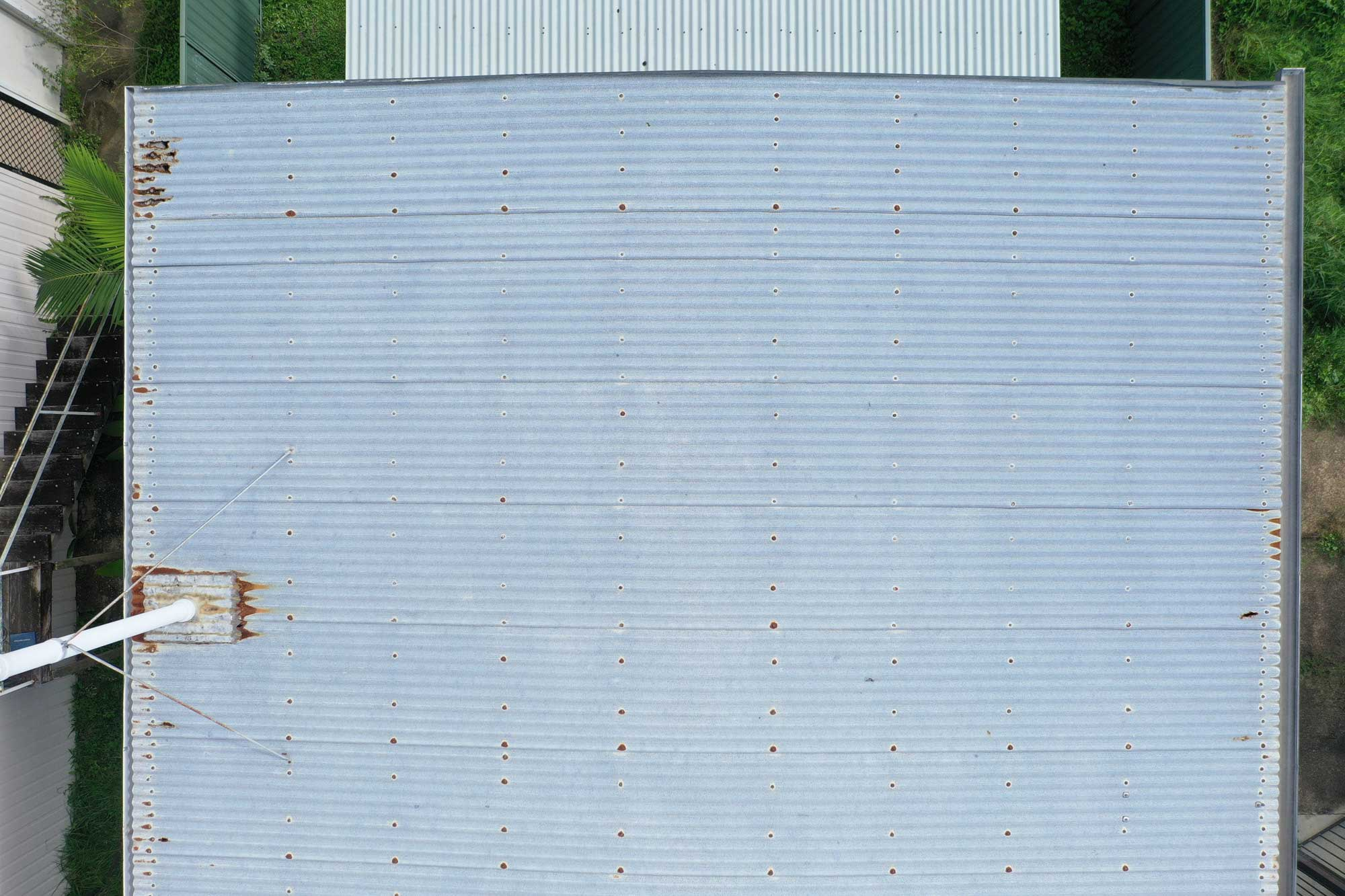 Drone photograph of rust on a roof at Deception Bay