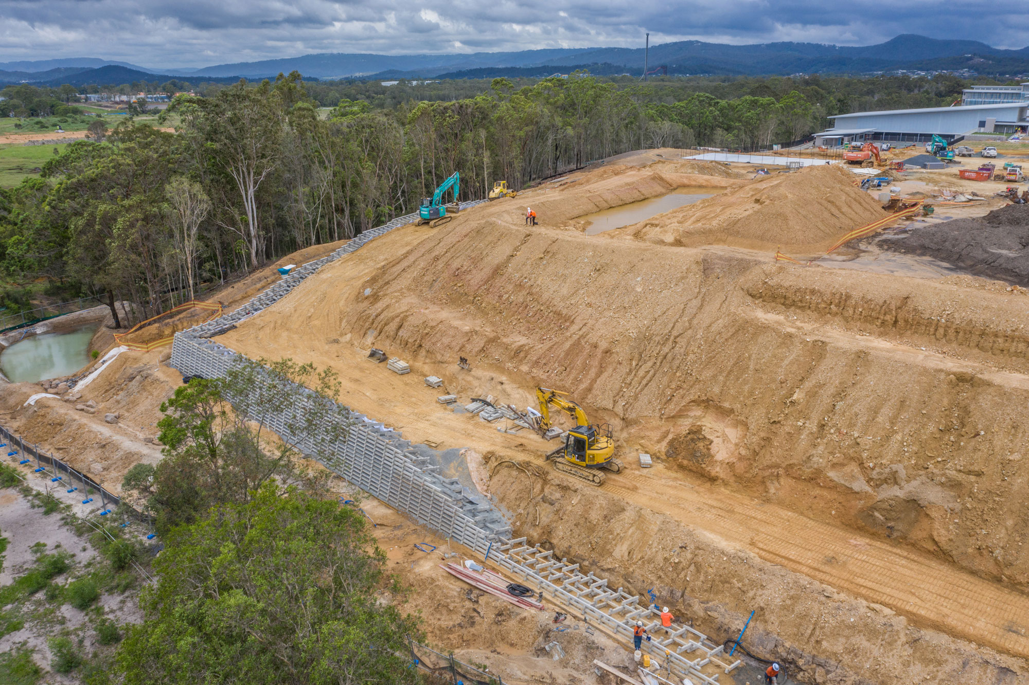 Drone photograph of a sleeper wall under construction at a state school under development at Coomera